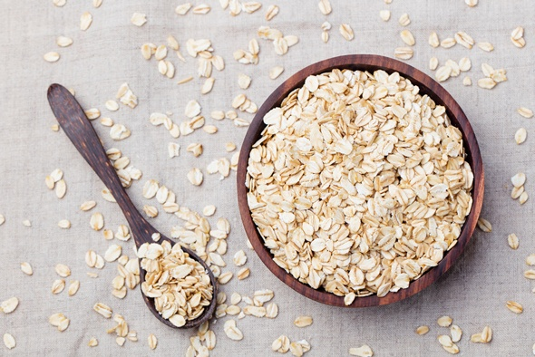 oats-in-wooden-bowl-and-on-wooden-spoon