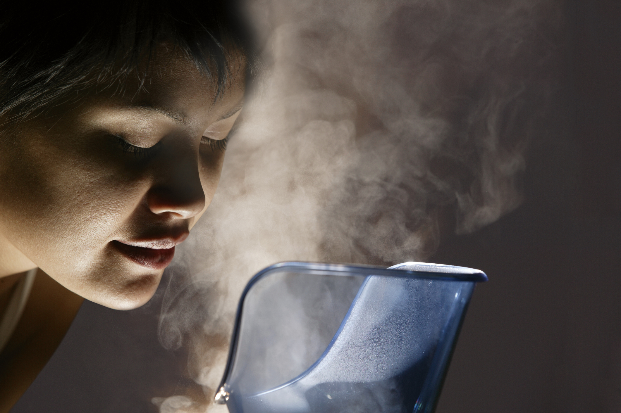 Woman steaming her face. Credit - livestrong.com